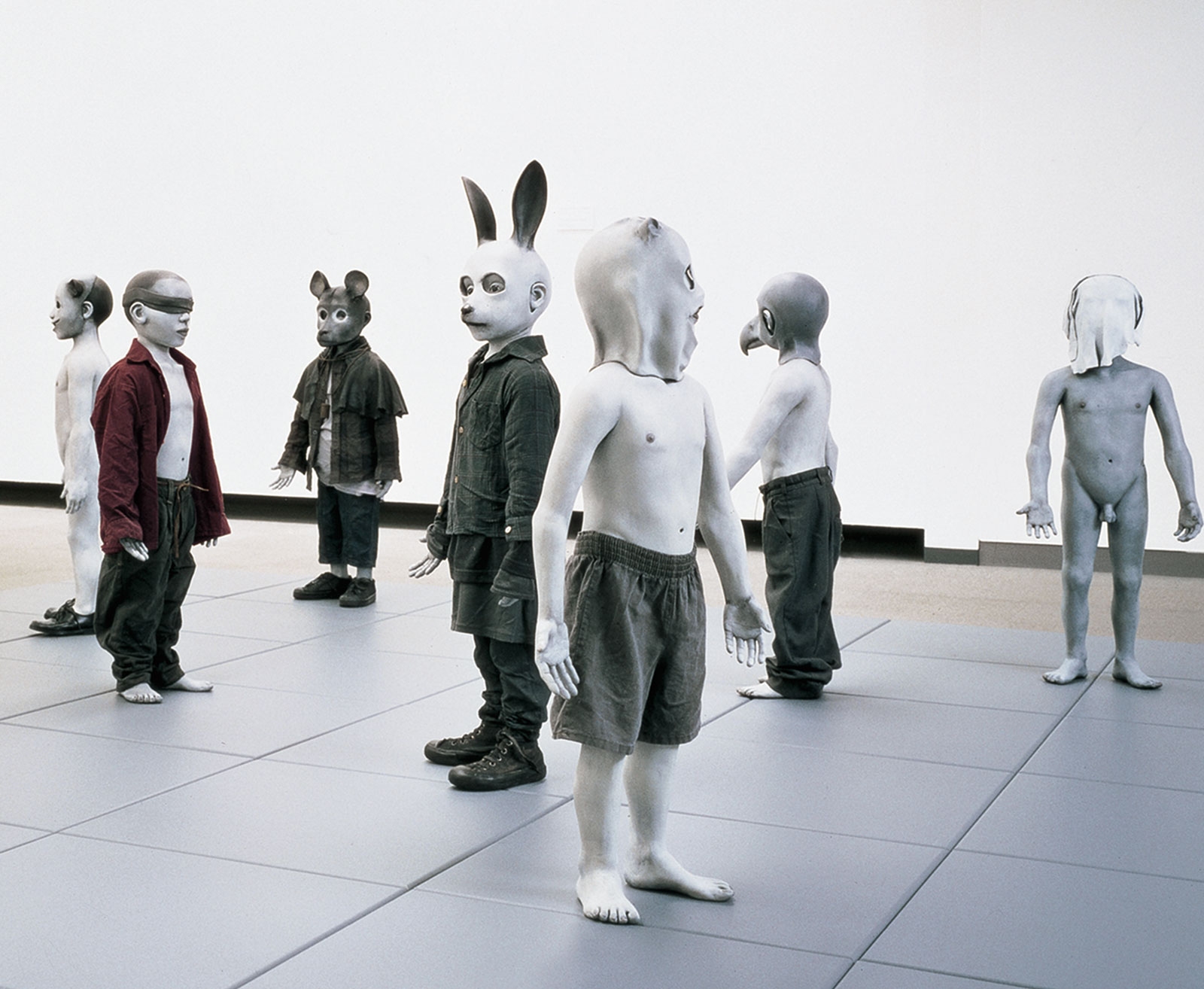 <i>Bom Boys</i> (1998 installation, 105 × 360 × 360 cm. Fiberglass; found clothing; oil paint; synthetic clay; fiberboard squares