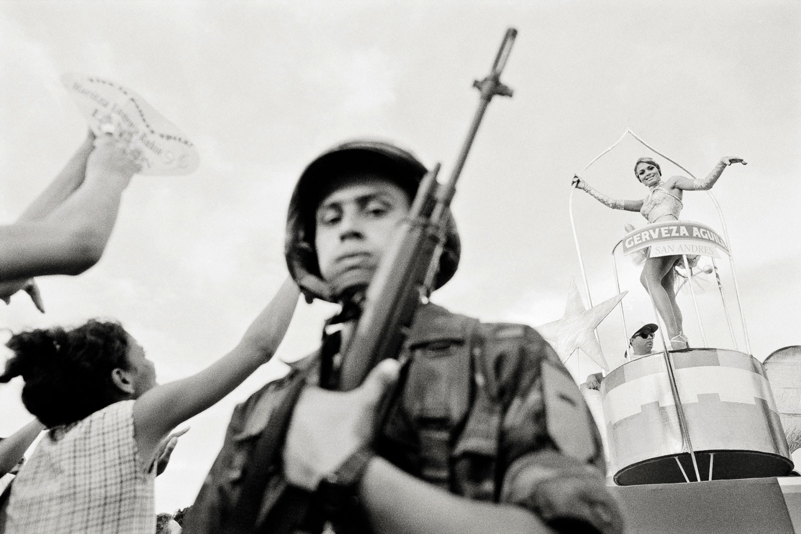 <i>Untouchable</i> (1996) At the National Beauty Contest in Cartagena, heavy ropes and tightly spaced soldiers must routinely push back spectators to make room for the floats