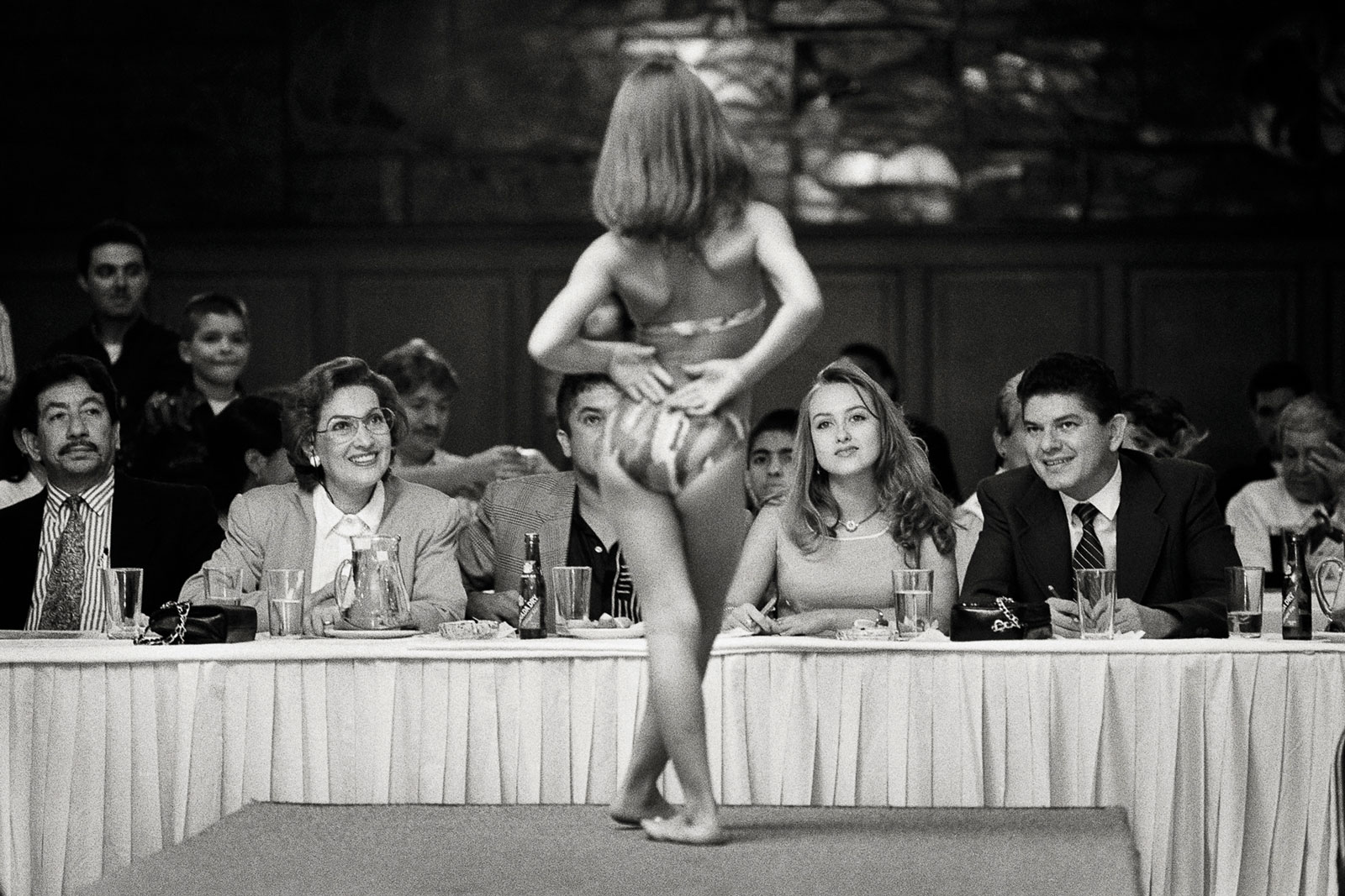 <i>Chica Barbie</i> (1996) At the Chica Barbie pageant in Medellín, a five-year-old rolls what will someday be hips in her best attempt at seduction. Modeling schools coach girls as young as four in the proper ways to be as coquettish as possible, on demand.
